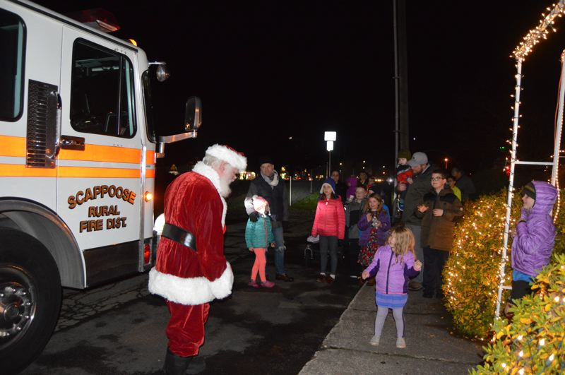 SPOTLIGHT FILE PHOTO - Santa Claus visits children at Heritage Park in Scappoose in 2017 during a holiday lighting celebration.