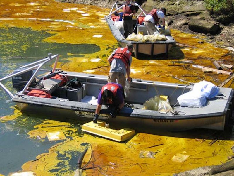 IMAGE COURTESY OF WASHINGTON DEPARTMENT OF ECOLOGY - A response team combs a river following a 2007 bio diesel fuel spill. A lease amendment request from an oil company doing business in Columbia County has renewed concern over oil spill risks and fire hazards.