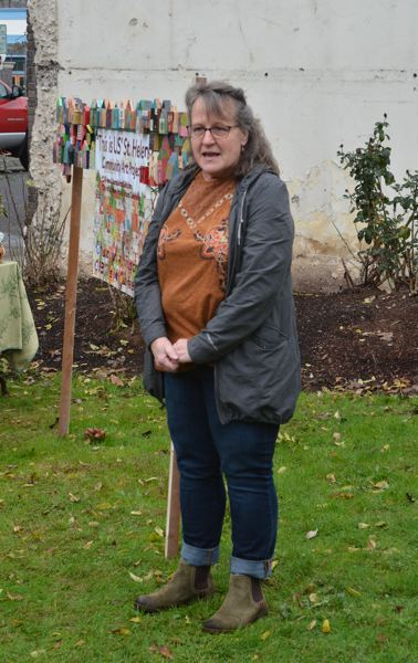 SPOTLIGHT PHOTO: COURTNEY VAUGHN - Joan Youngberg thanks visitors and talks about the idea behind the This Is Us St. Helens public art installation now on display in St. Helens during a public unveiling of the project Friday, Nov. 16.