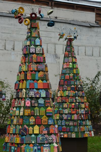 SPOTLIGHT PHOTO: COURTNEY VAUGHN - Tiny wooden houses affixed to tree-shaped wooden posts will be on display in the Columbia County Courthouse Plaza now through early January.