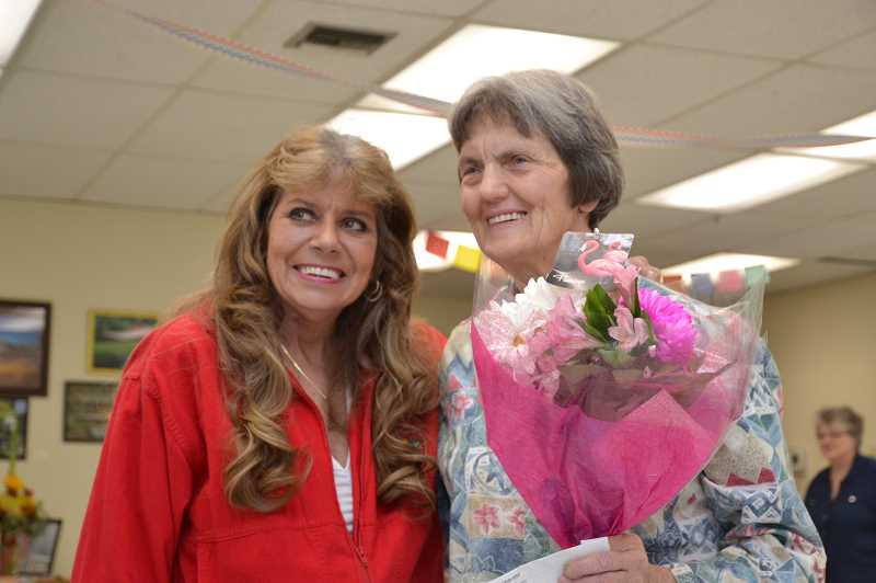 CONTRIBUTED PHOTO: FLYNN PHILLIPS - Earlier this month, community members gathered at a reception honoring Jan Melcher (right), who received the AARP Andrus Award.