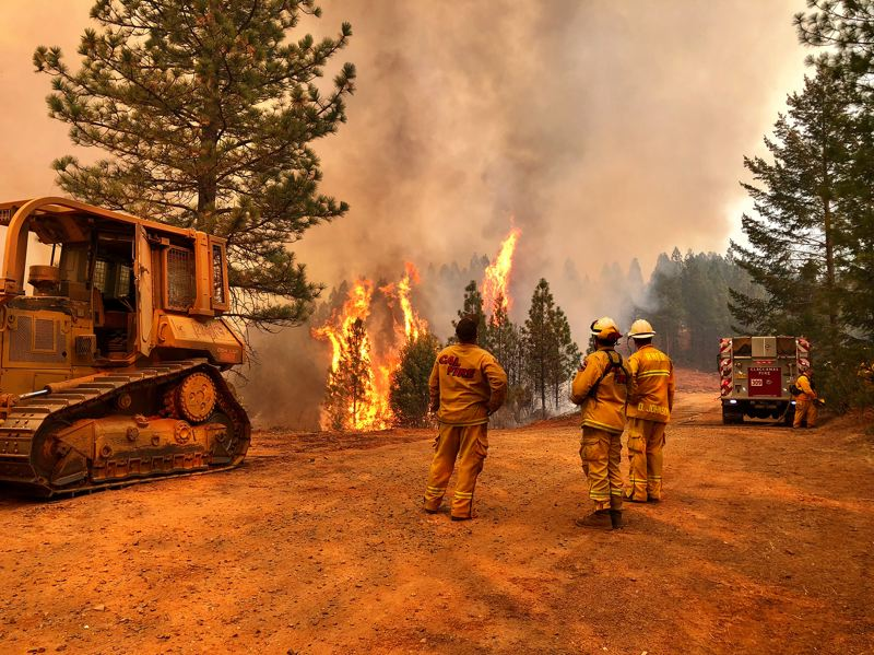 PHOTO: LT. BEN FERGUSON - A crew from Tualatin Valley Fire & Rescue watch as a forest is consumed in the deadly Camp Fire in California.