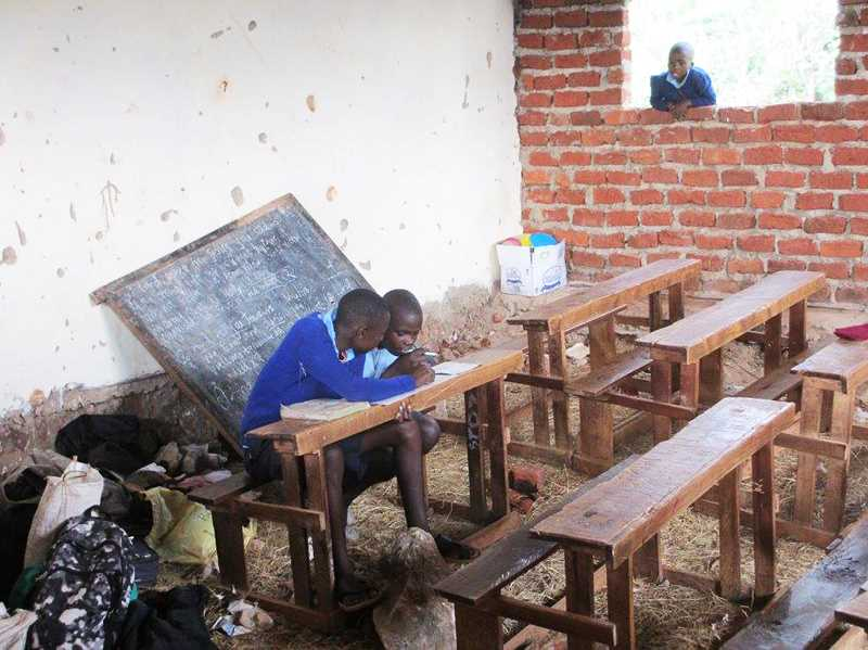 SUBMITTED PHOTO - Photos, from above: Students in rural Kenya stay after class to study in a primitive classroom created by Marifiki, a faith-based nonprofit organization. A foundation is set for expansion of the classroom in Kenya.