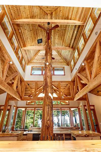 SUBMITTED PHOTO - Parrett Mountain Cellars, owned by Marlene and Dennis Grant, features a tasting room built from trees harvested on the property. The center of the tasting room also boasts a 28-foot cedar.