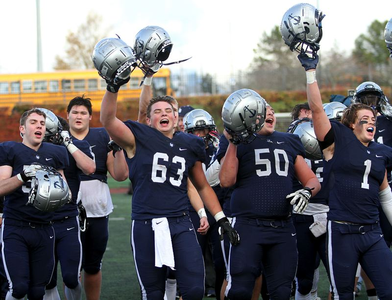 REVIEW PHOTO: MILES VANCE - Lake Oswego senior lineman Tanner Hall (No. 63) leads his team in cheers after the Lakers beat Jesuit 24-14 in the Class 6A state semifinals at Hillsboro Stadium on Friday.