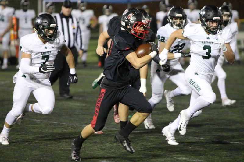 PAMPLIN MEDIA: JIM BESEDA - Clackamas' Anthony Talavera finds some running room in the first half of Friday's OSAA Class 6A semifinal against Sheldon at Hillsboro Stadium.