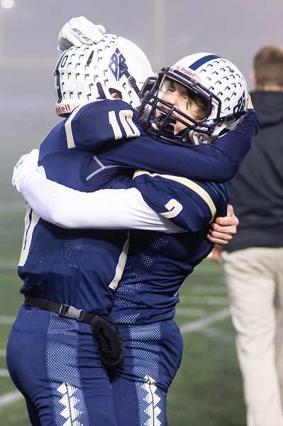 STAFF PHOTO: CHRISTOPHER OERTELL - Banks' Hayden Vandehey hugs teammate Jarred Evans following the Braves' game against Seaside, Nov. 24, at Hillsboro Stadium.