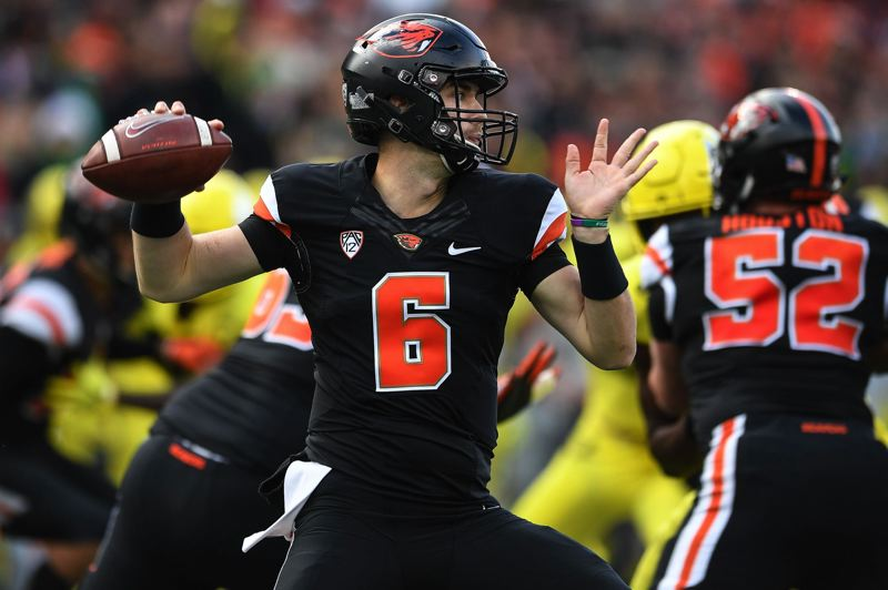 TRIBUNE PHOTO: CHRISTOPHER OERTELL - Oregon State quarterback Jake Luton winds up to throw a pass during the Civil War game won by Oregon, 55-15, on Nov. 22 at Corvallis.