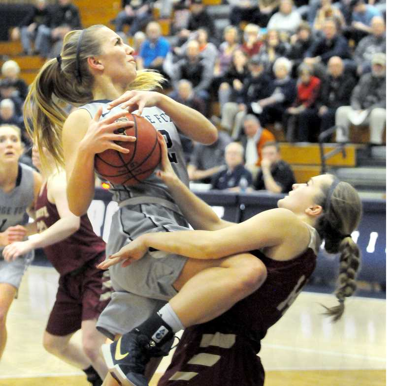 GRAPHIC FILE PHOTO - George Fox's Tavin Headings attacks the basket against Willamette in a January Northwest Conference contest.