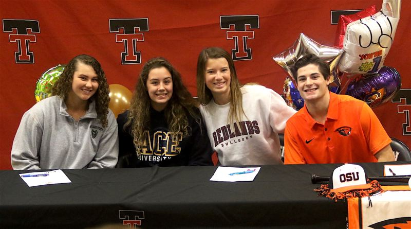 TIMES PHOTO: DAN BROOD - Tualatin seniors (from left) Emily Johansen, Avery Gales, Lauren Magnuson and Kyle Dernedde signed their national letters of intent last week.