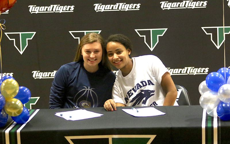 TIMES PHOTO: DAN BROOD - Tigard High School seniors Campbell Gray (left) and Gabby Brown signed their national letters of intent during a ceremony at the school.