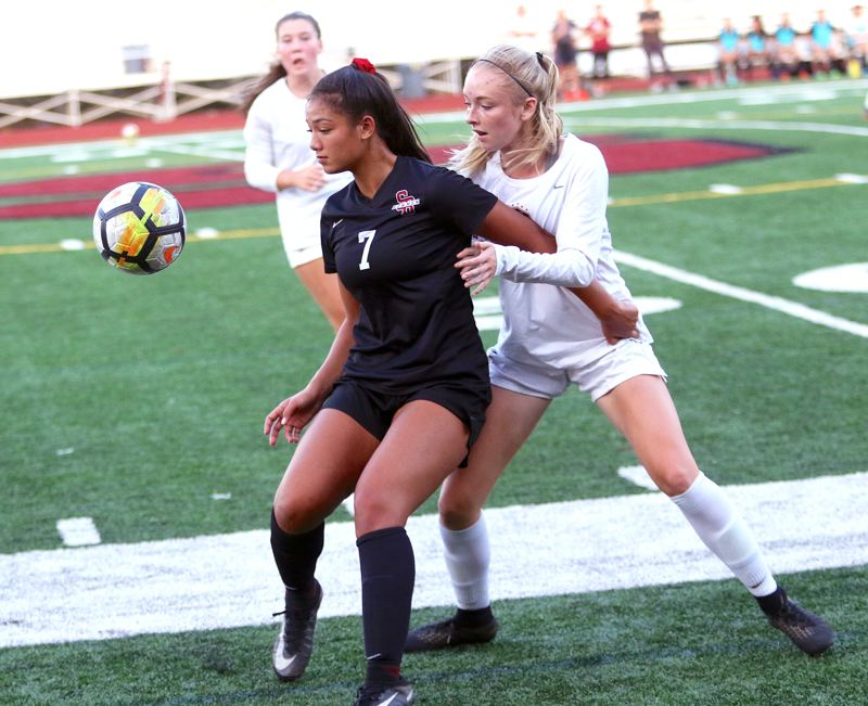 TIMES PHOTO: DAN BROOD - Sherwood High School senior Loma McNeese (left) was named the Pacific Conference girls soccer Player of the Year.