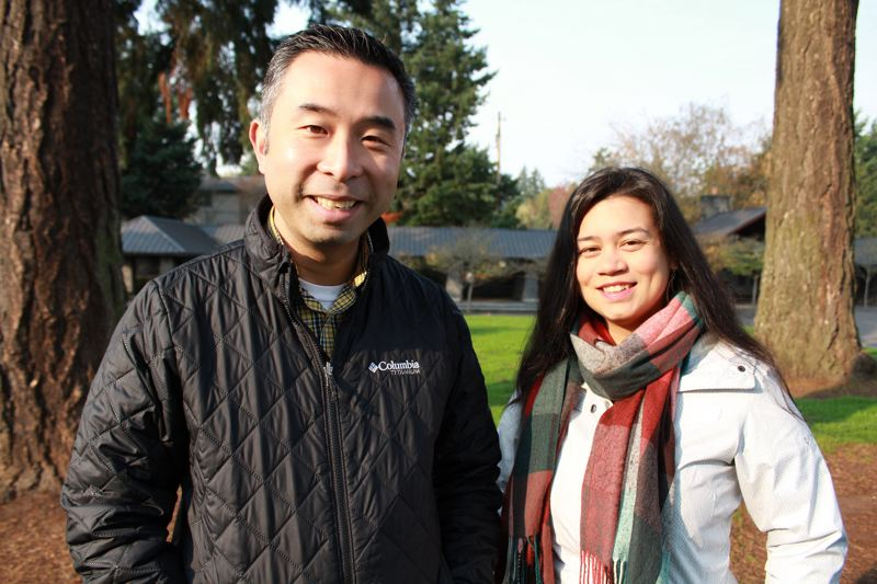 REVIEW PHOTO: SAM STITES - Lake Oswego City Councilor-elect Daniel Nguyen poses with campaign manager Chrissy Erguiza in Millenium Plaza Park.