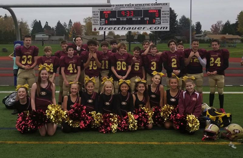 SUBMITTED PHOTO - Rowe Middle School football players and members of Mustang Youth Cheer celebrate winning the Tualatin Valley Youth Football League championship Nov. 10.