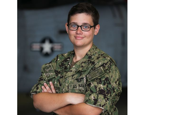 PHOTO BY GARY WARD - U.S. Navy Petty Officer 2nd Class Cari McPheeters is an aviation structural mechanic serving with HSC 28, known as the Dragon Whales.