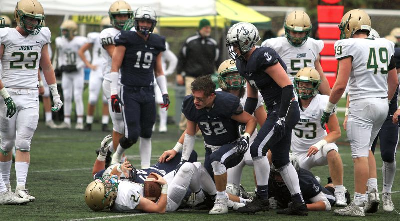 REVIEW PHOTO: MILES VANCE - Lake Oswego senior linebacker Gabe DeVille had something to say in his team's semifinal win against Jesuit and plans for more against Sheldon in Saturday's Class 6A state championship.