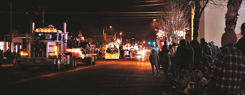VALERIE OLSON/SPECIAL TO THE CENTRAL OREGONIAN  - A cold, windy evening did not dampen enthusiasm among the parade crowd, who came prepared with fire pits, warm beverages, and lots of blankets, gloves and hats.