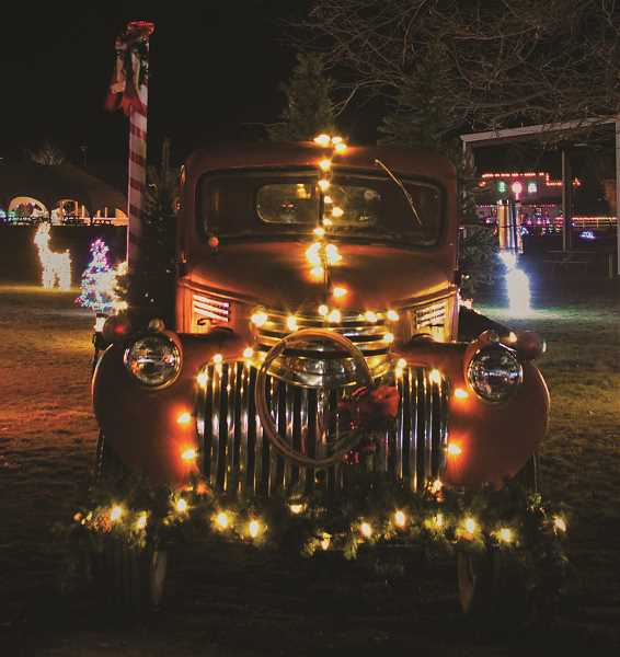 VALERIE OLSON/SPECIAL TO THE CENTRAL OREGONIAN  -  The Christmas in the Pines drive thru light display opened for the season Saturday evening, featuring several new displays. Pictured is an old truck decorated in holiday splendor.