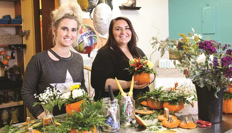 HOLLY SCHOLZ/CENTRAL OREGONIAN  - Boots and Blooms Floral owners Felicia Sumner, left, and Megan Whitlatch arrange flowers at their new Prineville flower shop.