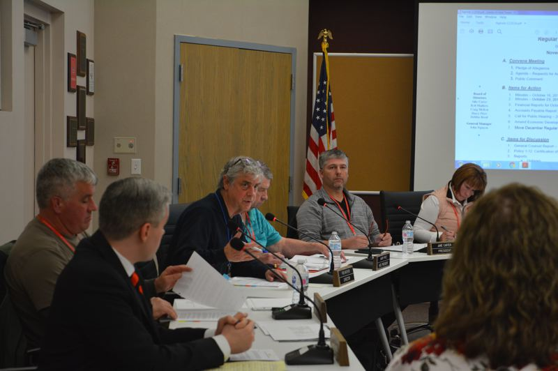 SPOTLIGHT PHOTO: COURTNEY VAUGHN - Columbia River PUD directors discuss an amendment to a resolution during a board meeting Tuesday, Nov. 20. Directors voted to increase the budget for a recently launched grant program.