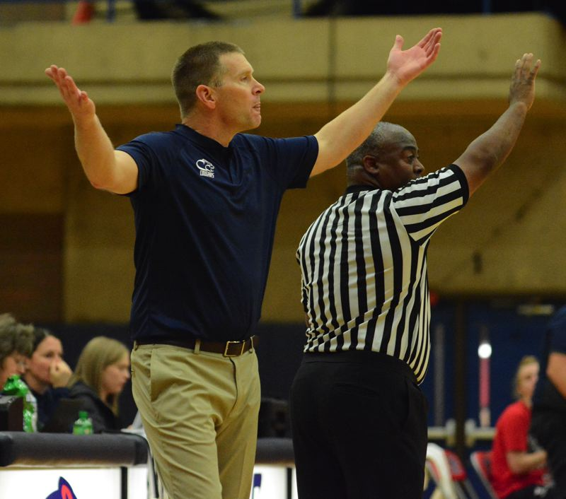 ESTACADA NEWS: DAVID BALL - Clackamas Community College womens basketball coach Jim Martineau looks for an explanation after a whistle in the Cougars 68-59 loss to SW Oregon on Friday.