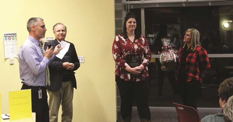 KRISTEN WOHLERS - Lorin Hilger (second from left) is honored with the CARE Award at the November school board meeting. Helping to present the award from left to right are Carus Principal Sam Thompson, Superintendent Trip Goodall and on the far right Kiwanis representative Brenda Griffin.
