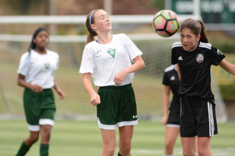 DAVID BALL/PAMPLIN MEDIA GROUP - High school injury reports analyzed by InvestigateWest and Pamplin Media show that girls are twice as likely to get concussions as boys in Oregon. Girls in the 13U age group, pictured above, are the youngest allowed to use headers.
