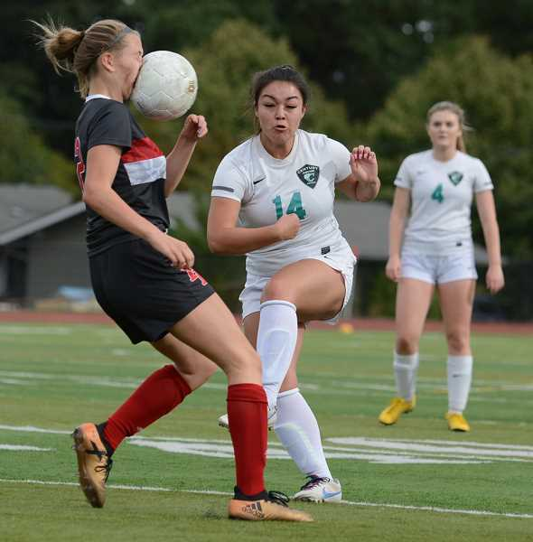DAVID BALL/PAMPLIN MEDIA GROUP  - Naomi Whitlock of David Douglas High School in Portland absorbs a ball to the face after a kick by Angela Silva of Hillsboro's Century High School goes unexpectedly high off her foot during a preseason match.