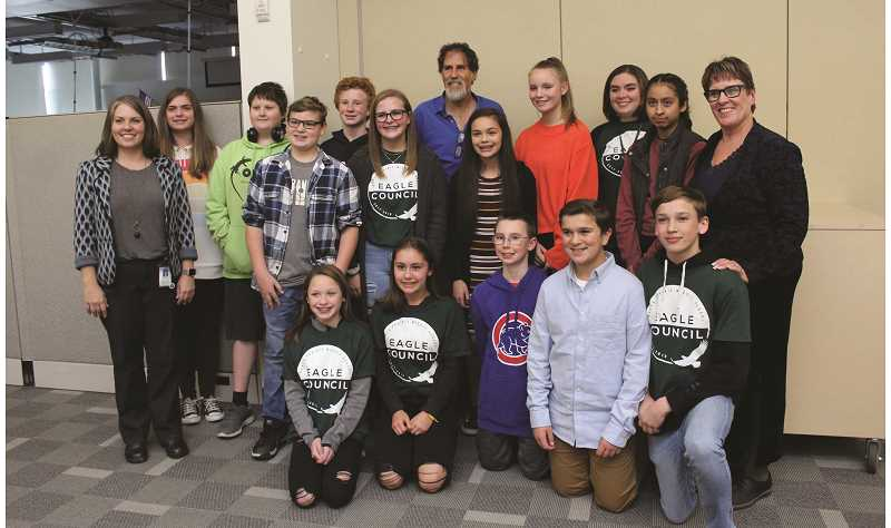 KRISTEN WOHLERS - Pictured with guest speaker Arik Ascherman (back center) are teacher Heather Anderson (left), Principal Jennifer Turner (right) and members of Baker Prairie's Eagles Council and Builder's Club.