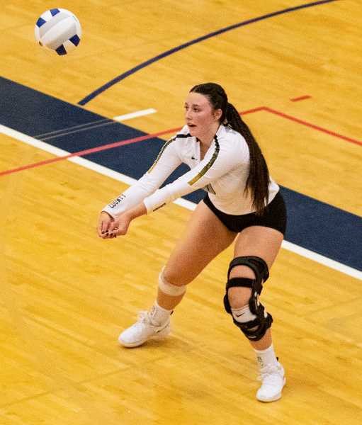 LON AUSTIN/CENTRAL OREGONIAN  - Kerigan Waibel passes a ball during the state tournament. Waibel started the season as an outside hitter but finished as a defensive specialist due to a serious knee injury.