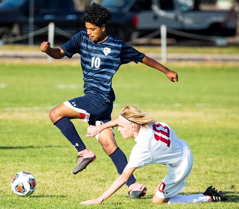 LON AUSTIN/CENTRAL OREGONIAN  - Elias Villagomez controls a ball during this past season. Villagomez, a junior, is one of several key returning players for the Cowboys.