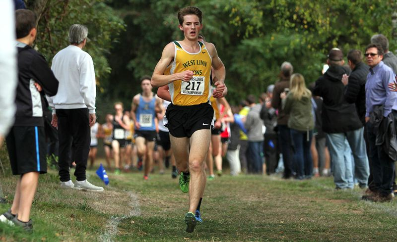TIDINGS FILE PHOTO - West Linn senior Kenney McElroy made the most of the end of his senior cross country season, running in the NXR Regional Championship and the Nike BorderClash.