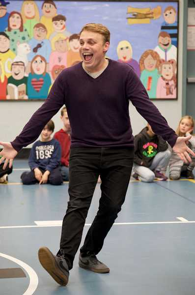 TIDINGS PHOTO: CLARA HOWELL  - Missoula Children's Theatre Director Billy Speed demonstrates a move before students give it a try.