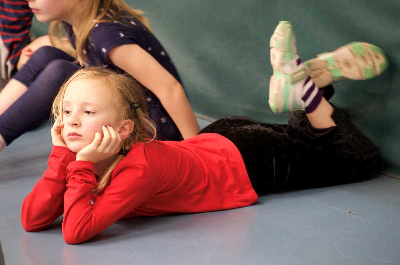 TIDINGS PHOTO: CLARA HOWELL  - Cedaroak Park Primary first-grader Arabel Weinham waits her turn while another group of students audition.