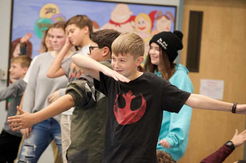 TIDINGS PHOTO: CLARA HOWELL  - Rosemont Ridge Middle School sixth-grader Nicholas Katko rehearses a dance shown by  Missoula Children's Theatre staff.