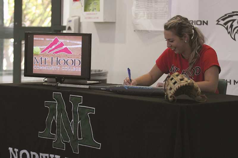 PAMPLIN MEDIA GROUP PHOTO: PHIL HAWKINS - North Marion's Baylie signs her letter of intent to play for Mt. Hood CC.