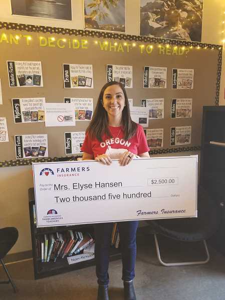 COURTESY PHOTO: ANNEKA MILLBROOKE - Elyse Hansen, an eighth-grade humanities teacher at North Marion Middle School, was surprised last Monday with a check for a $2,500 grant from Farmers Insurance.