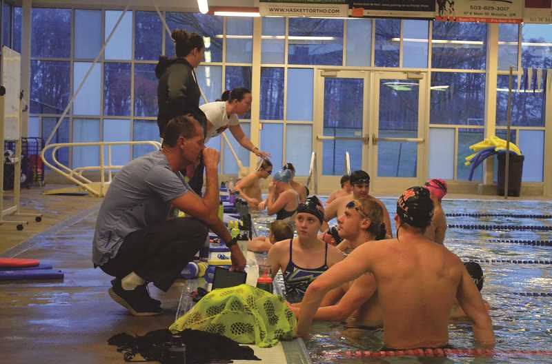 PIONEER PHOTO: TANNER RUSS - Oregon City Swim Team coach Rick Wheeler works with Molalla swimmers as a part of the OCST-South's first practices.