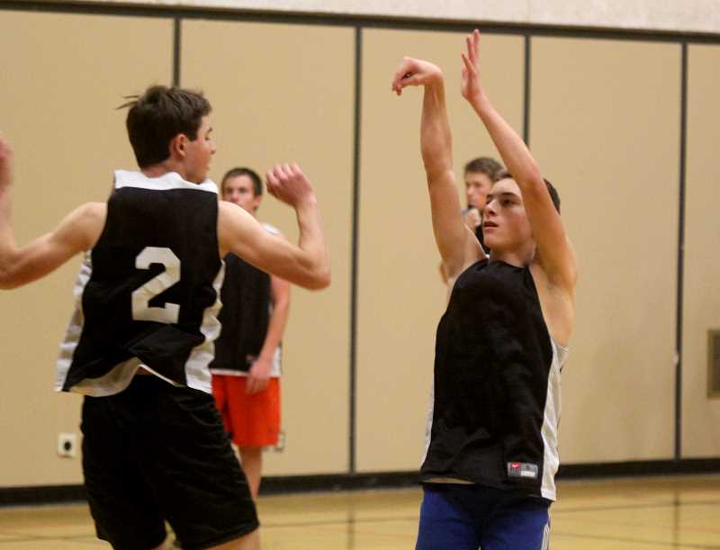 STEELE HAUGEN - Luke Spinelli shows his shooting form during a 3-on-2 drill for Culver basketball.