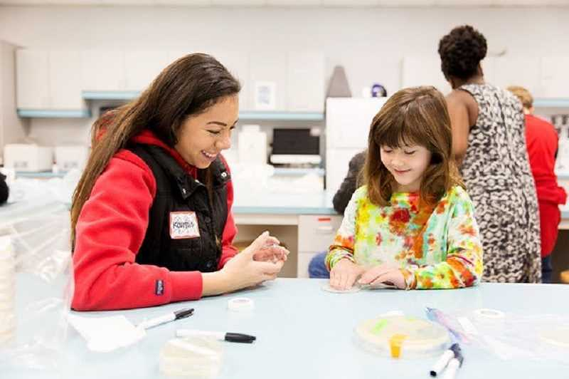 COURTESY PHOTO: PACIFIC UNIVERSITY - Pacific students and Layla Khoja-Herr work with a bacterial plate at Biotopia.