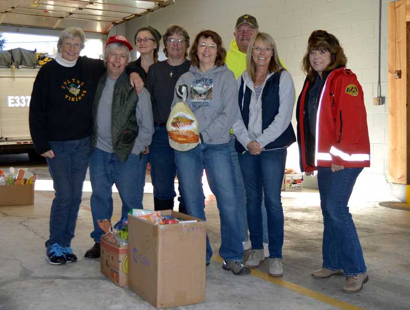 PIONEER PHOTO: CINDY FAMA - Volunteers gathered to assemble Thanksgiving boxes on Nov. 17.