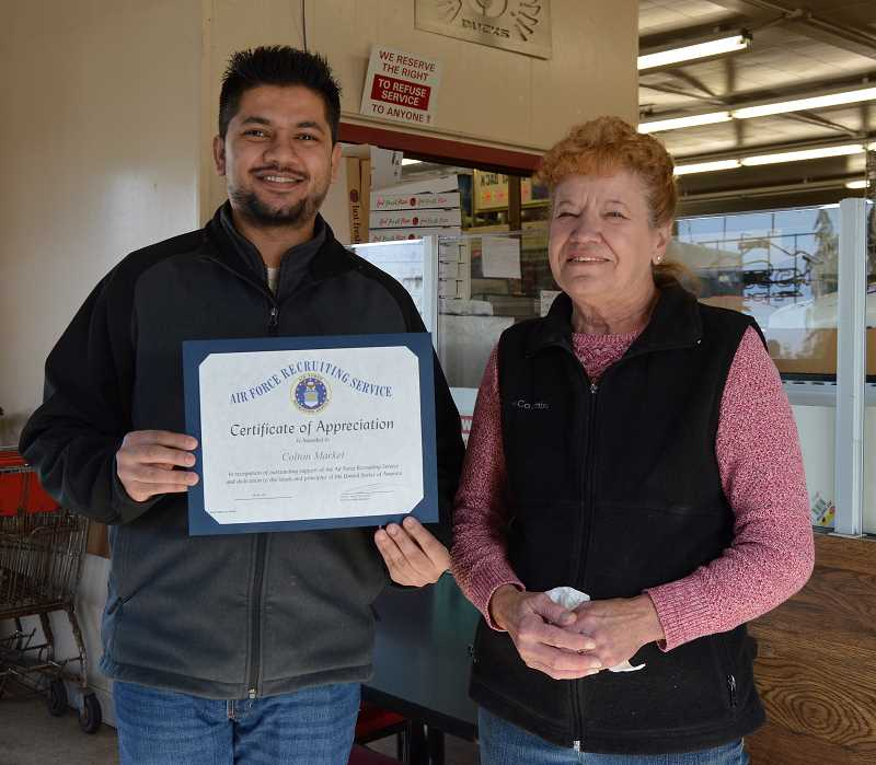 CINDY FAMA - Abdul Saleem and Linda Welsh of Colton Market show off the Certificate of Appreciation.
