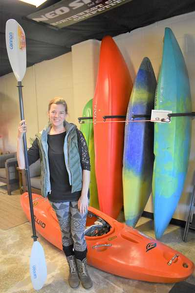 ESTACADA NEWS PHOTO: EMILY LINDSTRAND - Tanley Dickson shows off equipment available for purchase inside of Clackamas River Outfitters new store.