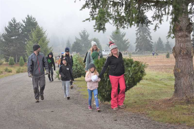 ESTACADA NEWS PHOTO: EMILY LINDSTRAND - Visitors to the Historic Kirchem Tree Farm bring back the holiday wares they found.