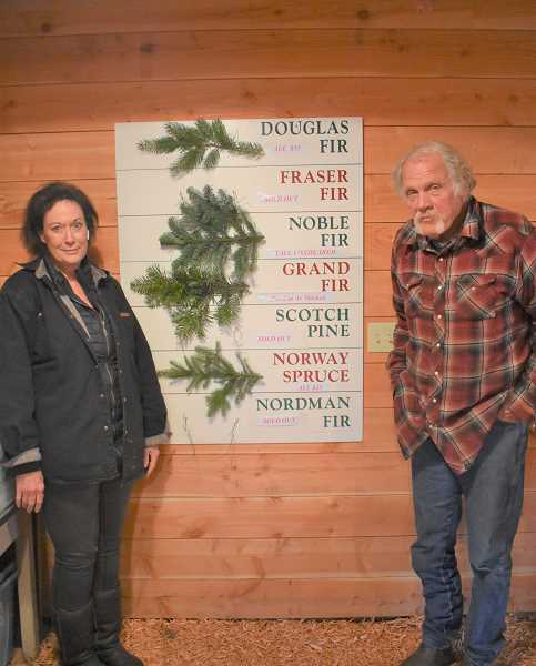 ESTACADA NEWS PHOTO: EMILY LINDSTRAND - Cher and Reg Tollefson are the hosts at the Historic Kirchem Tree Farm, connecting customers with the opportunity to choose and cut their own Christmas trees.