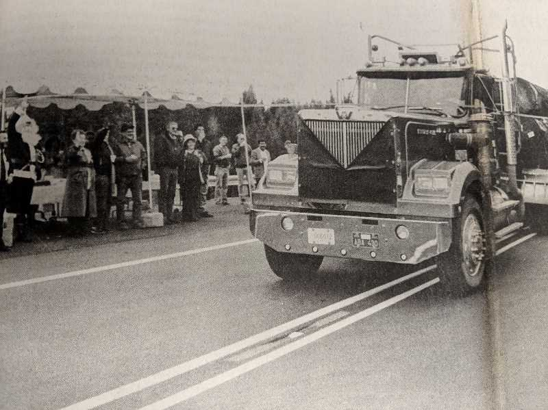ARCHIVE PHOTO - In 1988, a truck from Reisch Logging Company broke the ribbon during the opening ceremony of a new six mile stretch of Highway 224 near Estacada.