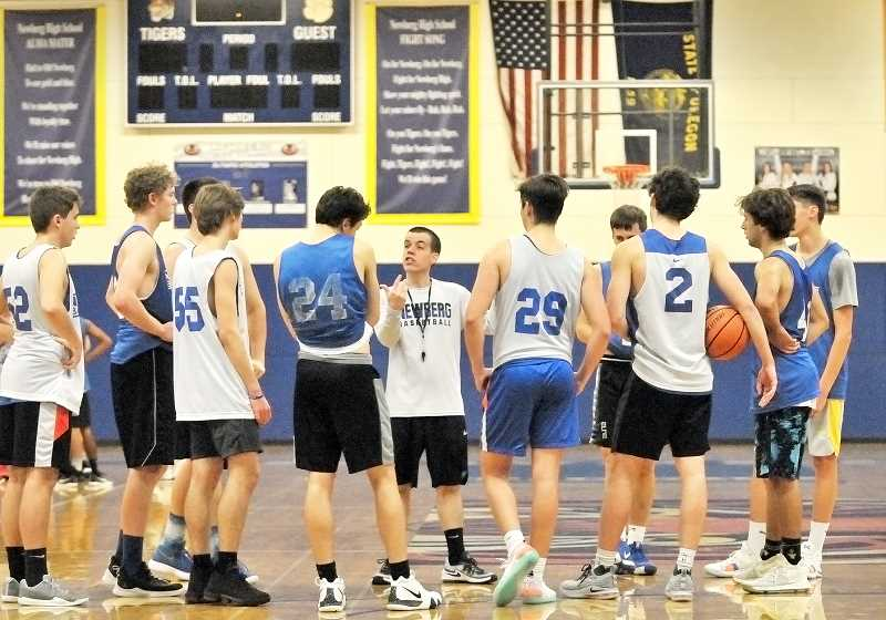 GARY ALLEN - Tigers coach Mark Brown instructs his team during a practice last week.