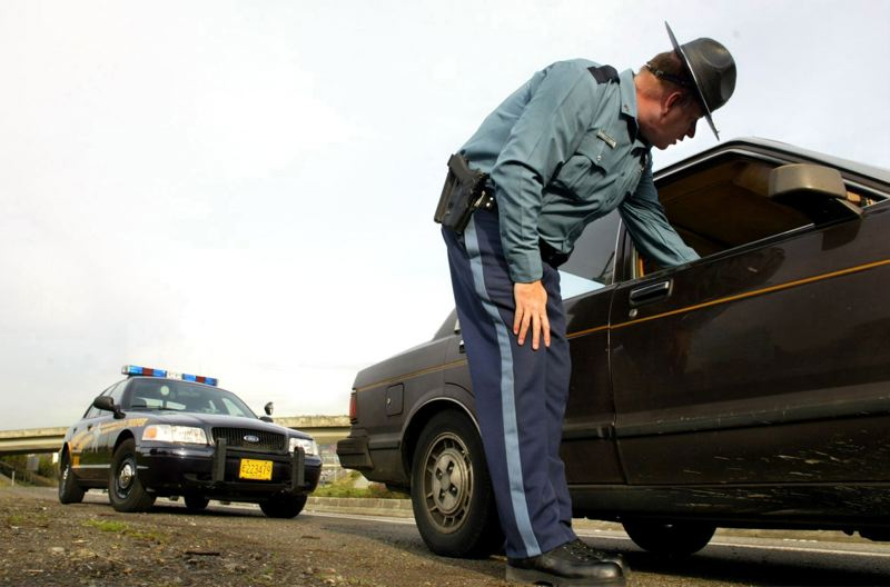 PAMPLIN MEDIA GROUP FILE PHOTO - Gov. Brown's proposed budget also would add money so Oregon State Police can put more troopers on the state's highways.