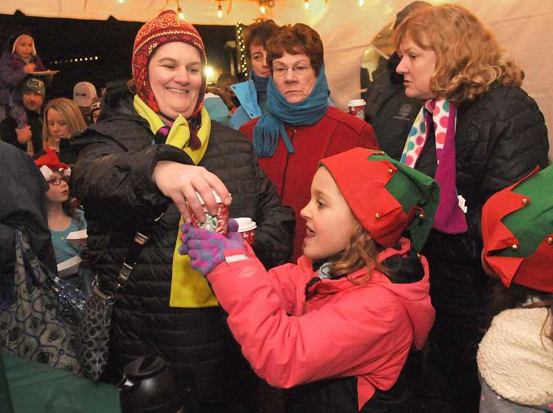 TIDINGS FILE PHOTO - The Community Tree Lighting is one of the City's most popular events, and many families attend every year.