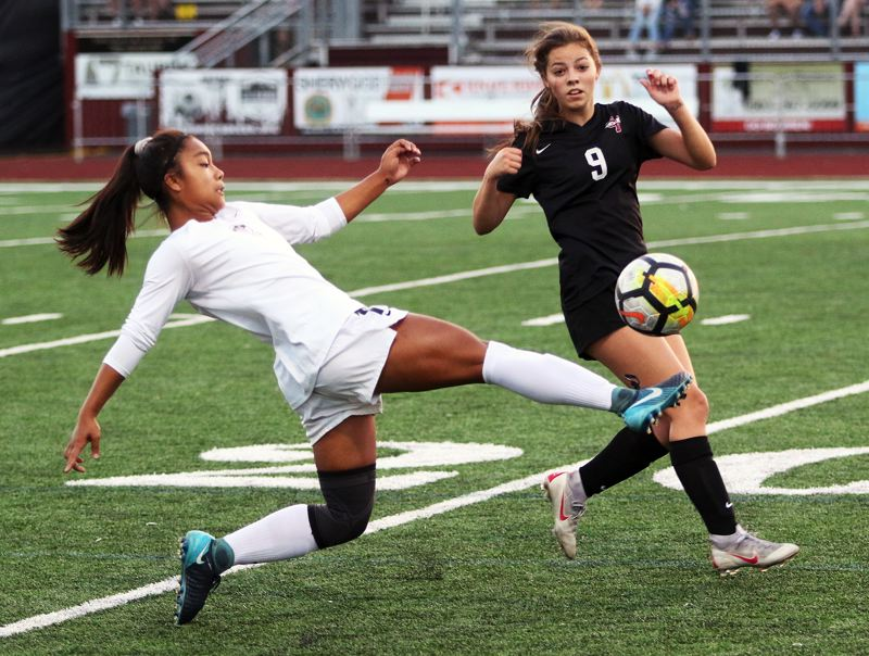 TIMES PHOTO: DAN BROOD - Tualatin sophomore forward Cally Togiai (left) earned first-team All-Three Rivers League honors for the second year in a row.